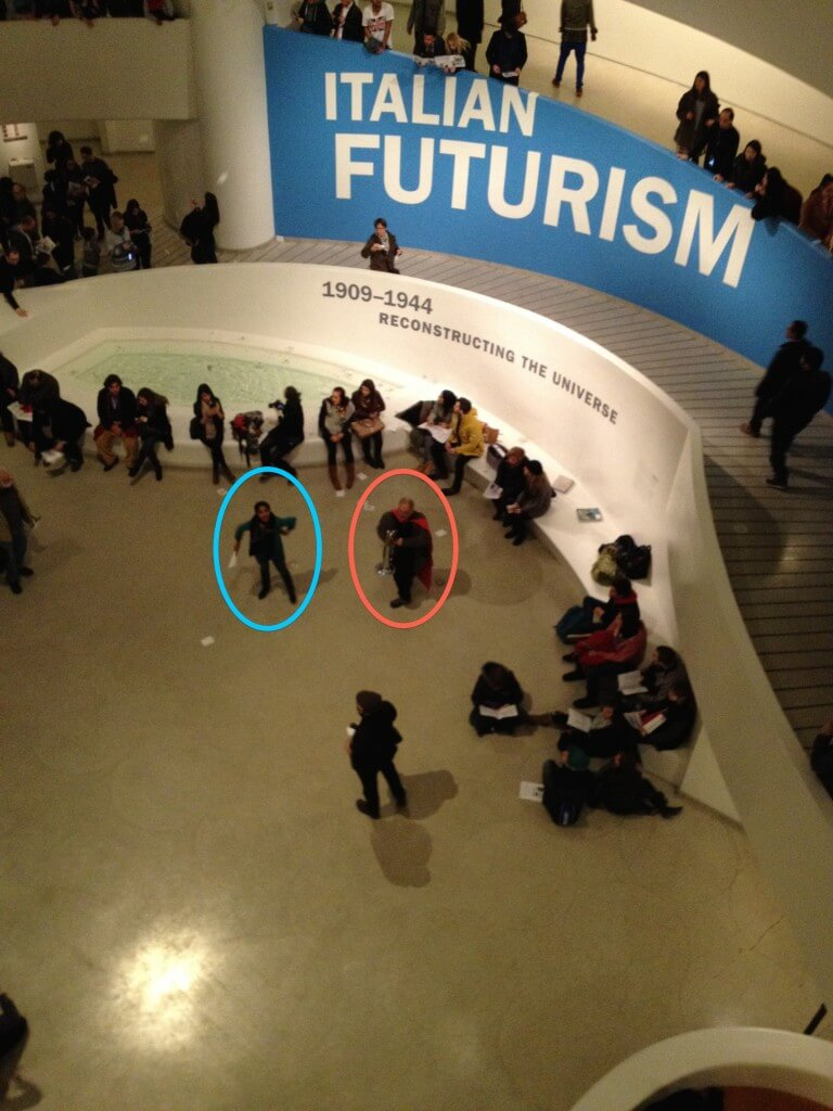 protesters in the Guggenheim Museum chanting