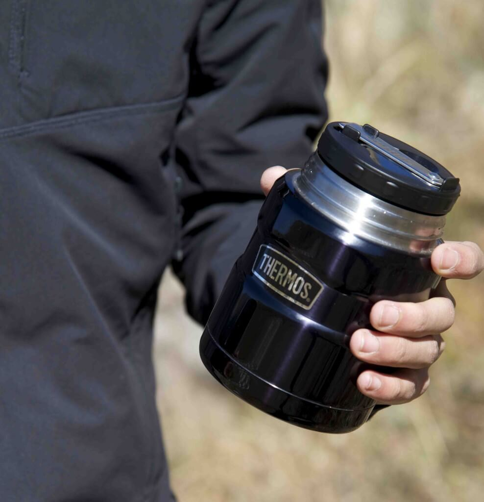 thermos being held