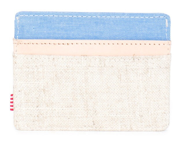 Herschel Supply slim wallet. The creamy white and light blue colors invoke a casual beach vibe. This wallet has a few pockets for holding cash and cards and is compact.
