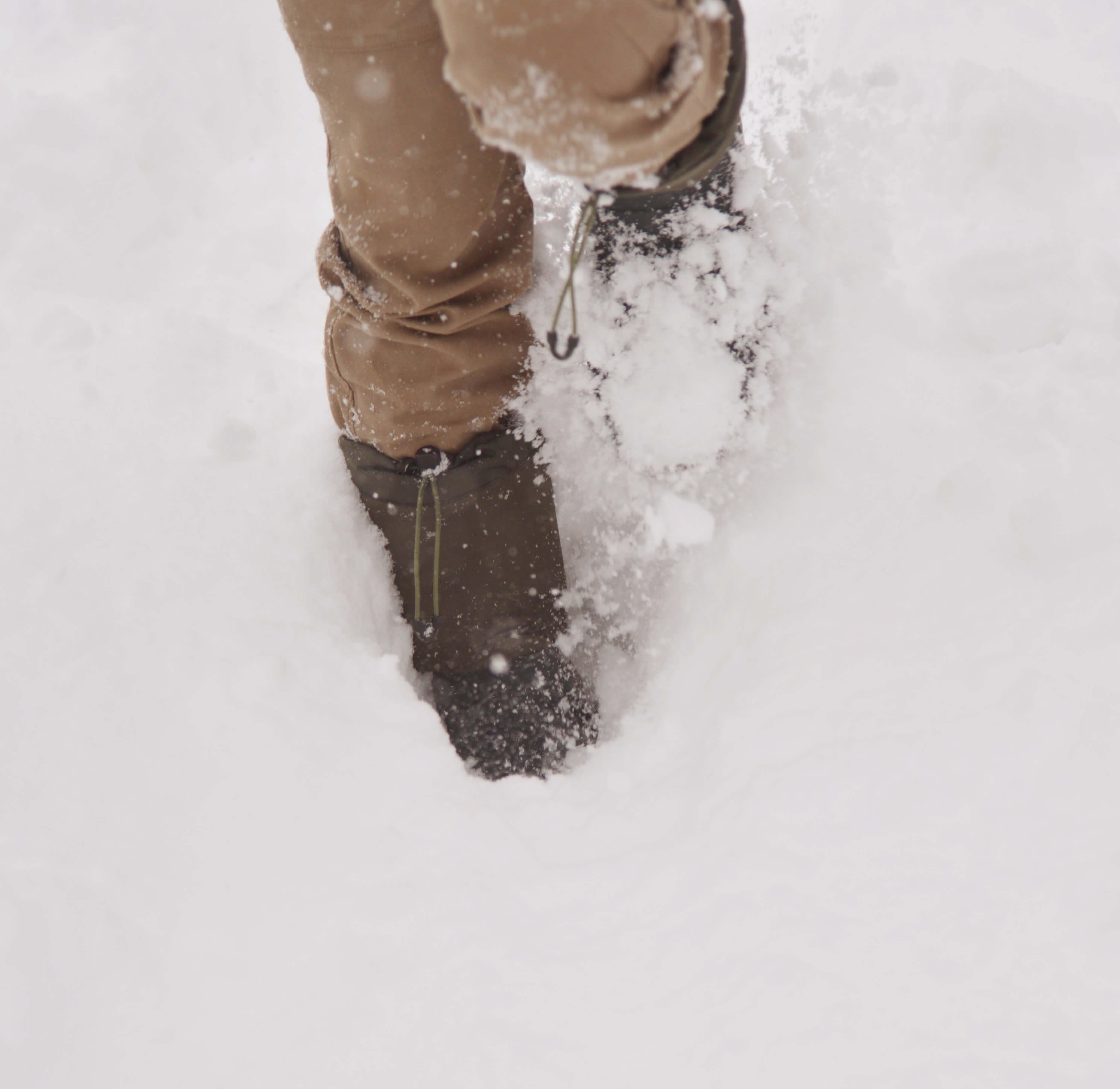 Walking through snow with the Kamik Coldcreek boots and Stio pants