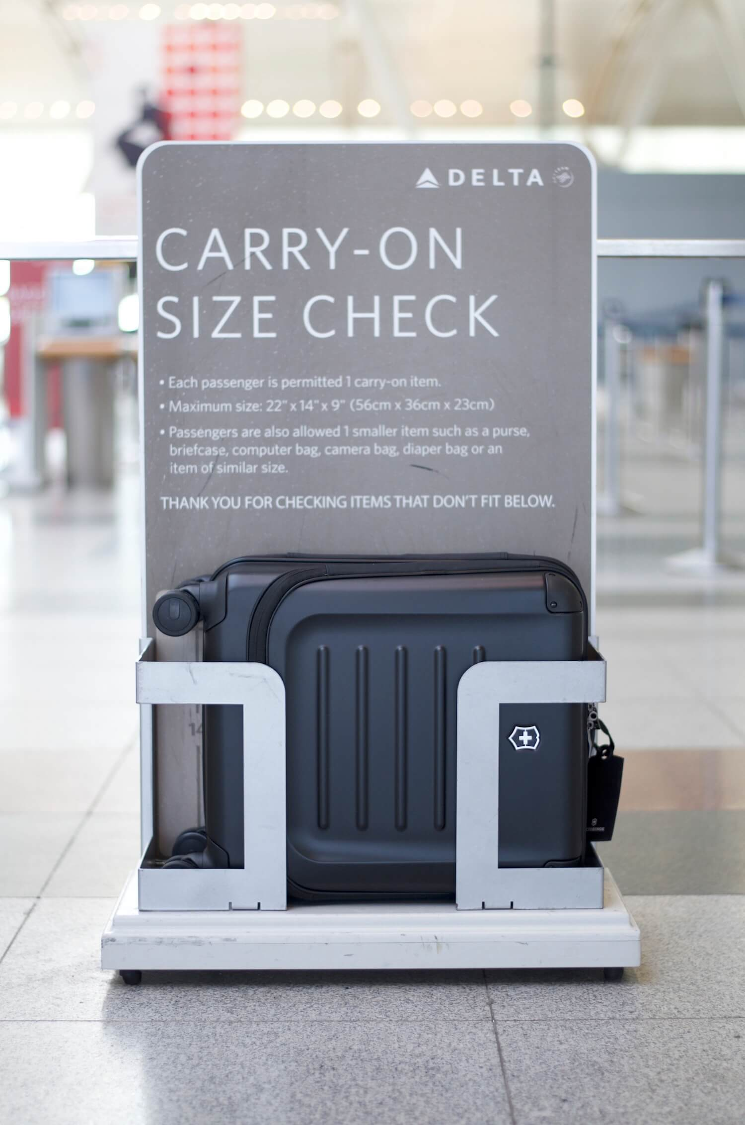 The Spectra luggage is within Delta's carry-on restrictions