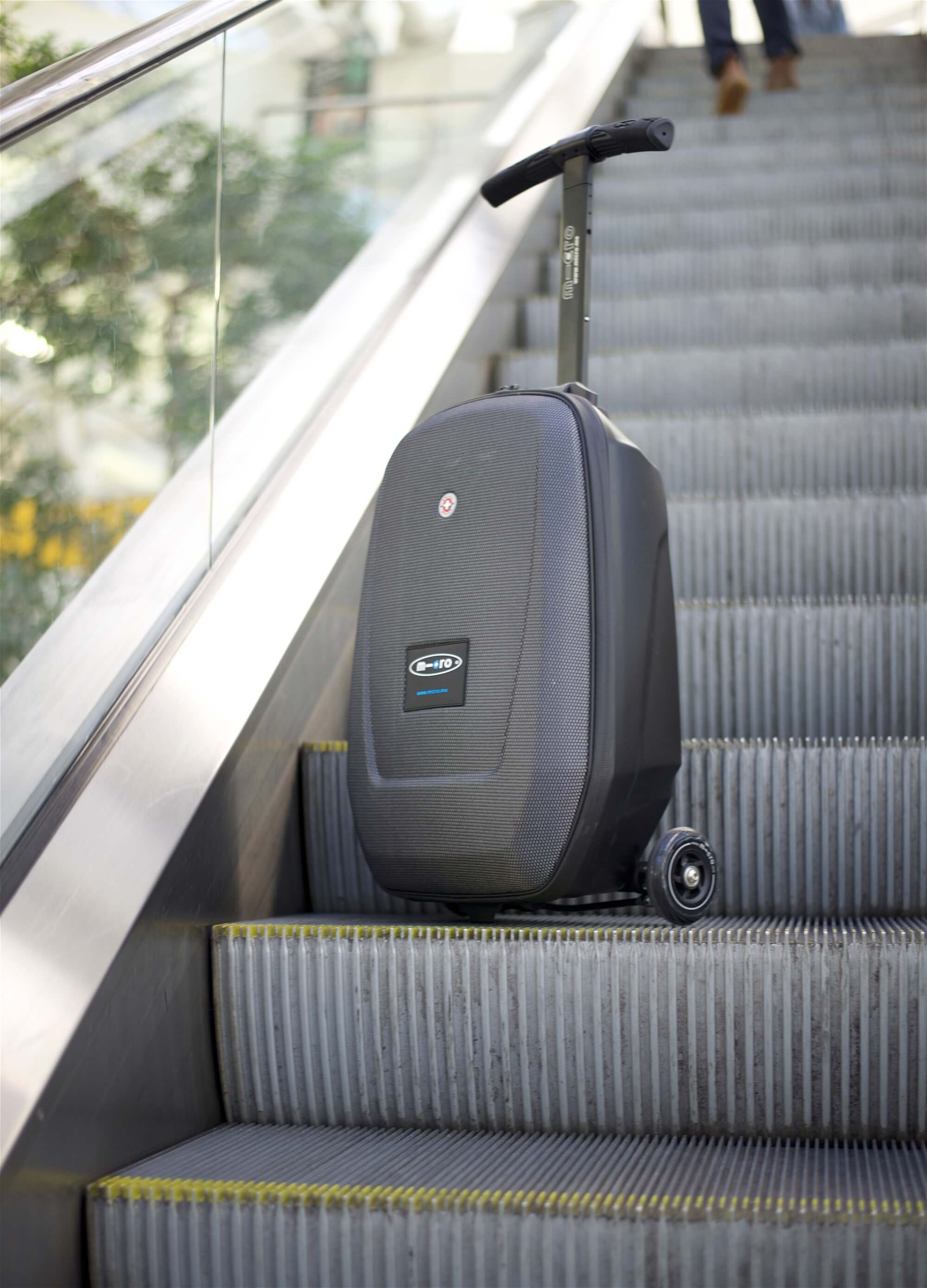 It's best to fold the luggage up before going on the escalator.