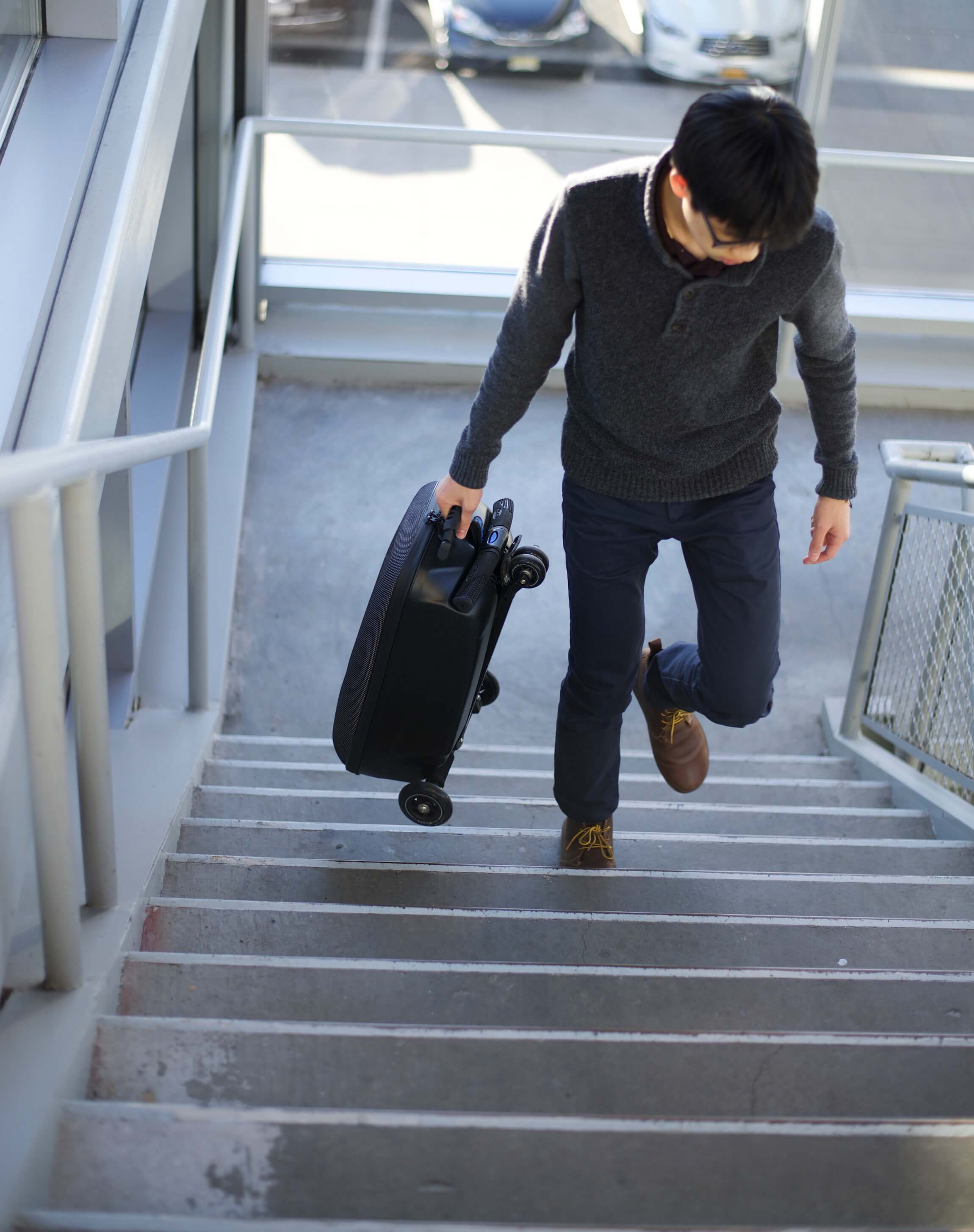 Carrying the Micro Luggage up the stairs by its handle