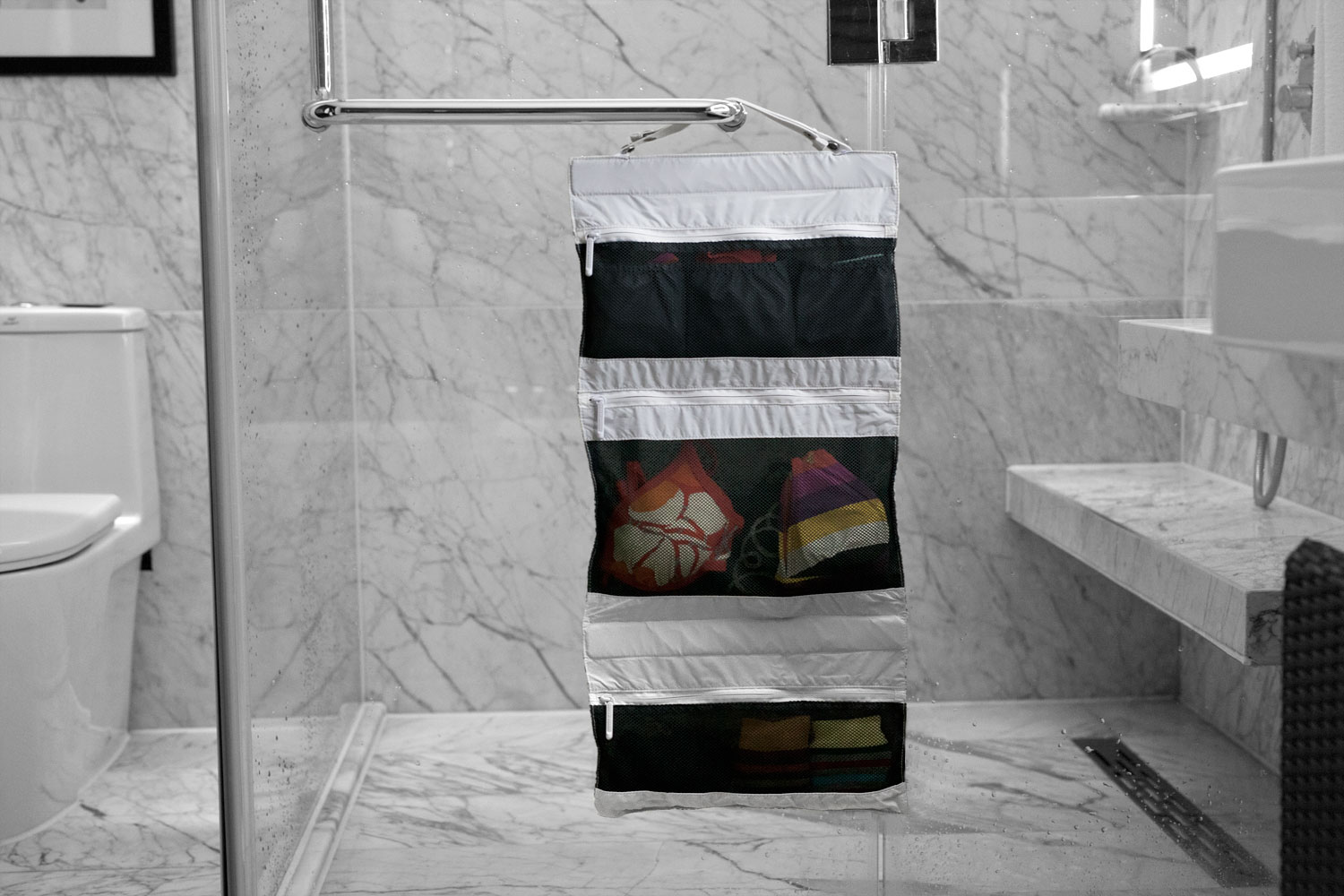 The organizer can be hung in a bathroom, closet or almost anywhere
