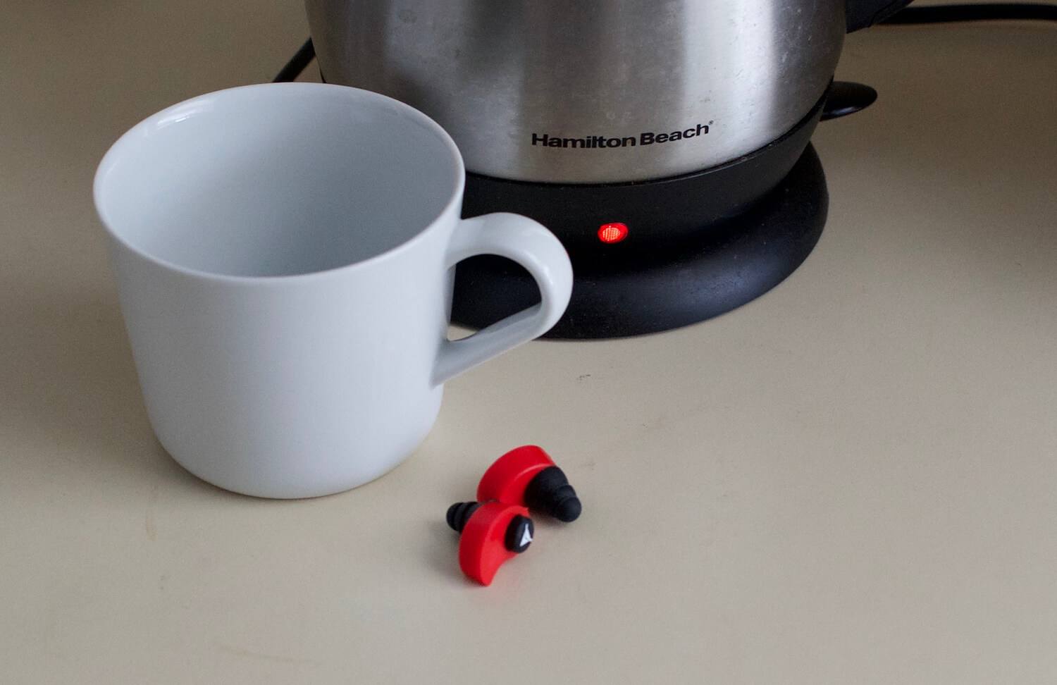 Boiling water to heat the earplugs.